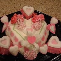 Heart Cake Large heart cake with heart cup cakes cover with fondant.