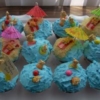 Bear Beach Party Cupcakes I made these for my Father's Birthday today. The design is from www.bakerella.blogspot.com They are vanilla cake with Indydeb's...