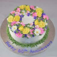 Gram And Gramps Celebrating 60 Years Together This is a french vanilla doctored cake mix with Wilton Class Buttercream icinf and royal icing flowers. Wilton Buttercream is not my first...