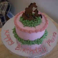 Moira's Meadow This is a 6 inch, 3 layer cake. The horses are chocolate transfers. It was a prototype cake.