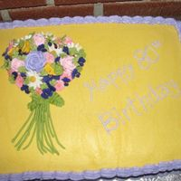 Grammie's Garden Bouquet This is a cake I made for my Grandmother's 80th Birthday Party. It is a 1/2 sheet cake, iced in buttercream with royal icing flowers....