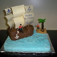 Henry's 4Th Birthday Made this for grandsons birthday. Used so many pirate cakes on cc as inspiration so thanks to all. Ship is RKT, covered in fondant.
