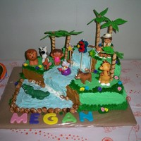 Megan's Three I made this for my granddaughters third birthday. Thanks to rnp3603 for the inspiration. Dora, Diego and animals are toys. I did not feel I...