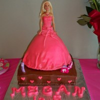 Megan's 5Th Birthday Barbie doll done for granddaughters birthday. Only second time to cover a cake with fondant.