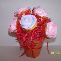 Cupcake Bouquet I did this bouquet to sell in a local candy store for valentines... This was my first one!!! Still trying to perfect them!!!