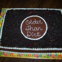 60Th Birthday Cake   Chocolate cake with crushed oreos as the dirt and gummy worms....