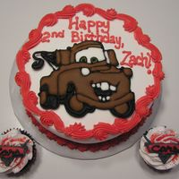 Mater Buttercream iced cake and cupcakes with color flow mater and Cars logo.