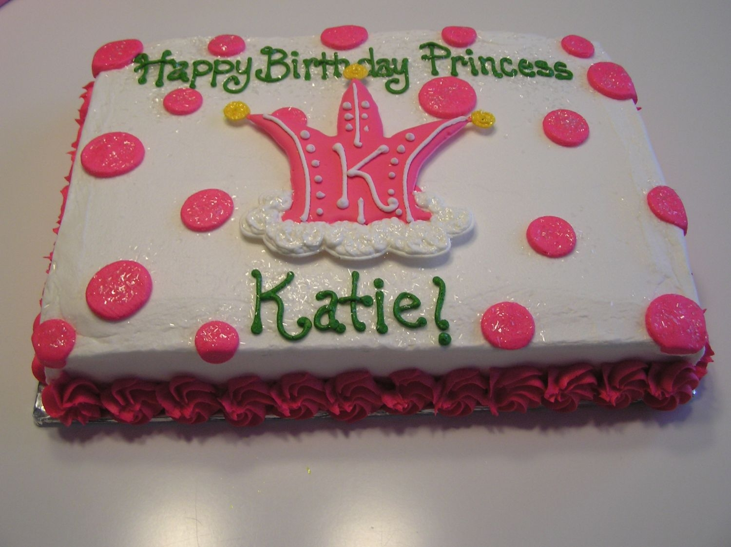 Princess Cake The crown on top is color flow, the rest is buttercream with a cute rosette bottom border.