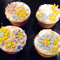 Pastel Flower Cuppies I was bored and just messing around with these. I wish I had made the fondant more realistic, dusty colors as opposed to pastels. The...