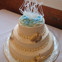Sailboat Theme Sailboat, seashells accent this 3 - tiered cake.