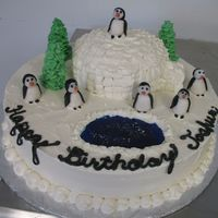 Happy Birthday Penguins This cake is gluten and dairy free for a young boy with allergies. The igloo is cake covered with frosting. The trees are frosting as well...