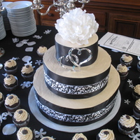 Black And White Gluten Free Wedding Cake This black and white cake is 100% gluten free. We loved the cake and the addition of some cupcakes around the bottom.