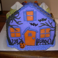 Haunted House Cake I froze the chocolate cake and iced with buttercream icing, covered in fondant and icing decoration.