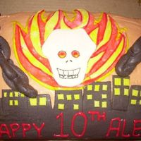 Ghost Rider Cake For my son's birthday, he chose one layer of red velvet cake and one layer of devil's food cake and he actually sketched out the...