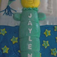 Glow Worm This cake was done for my nephew's first birthday. It was a half sheet for the bed and a glow worm made out of fondant.