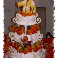 Mom's 70Th Birthday Cake This was a 3-tier birthday cake with fresh flowers. Iced in buttercream.