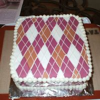 Argyle Birthday Cake I made this for a girl at work. My first time working with fondant (as I'm sure you can tell). Also my first square cake. I learned a...