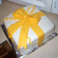 Course 3 Bow Cake We didn't have time in class to put the flowers on or the border actually. I used MMF for the cake covering and wilton fondant for the...