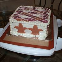 Side View   I couldn't figure out how to make the argyle pattern so down on two sides of the cake so I put the fleur de lis on two sides lol.