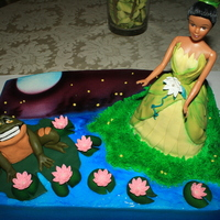 Princess And The Frog Based this cake off of a picture from a movie poster. Marble choc and vanilla cake w/buttercream. Fondant frog and dress. Wondermold pan...