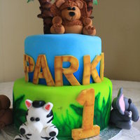 Jungle Animals This was based off a picture the client showed me. Choc cake with Fondx fondant, airbrushed tiers, and fondant animals. The lion was my...