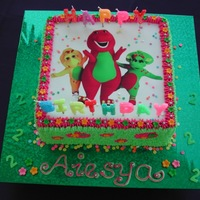 Barney Edible Image and fondant flowers. Alphabets are candles.