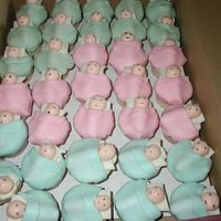 Lots And Lots Of Babies Cupcakes made to look liks little babies all bundles up