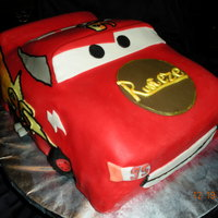 Lighning Mcqueen This was a carved cake put of chocolate and buttercream, Then covered in fondant.