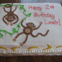 Monkey Cake This is a sheet cake covered in buttercream with fondant accents.
