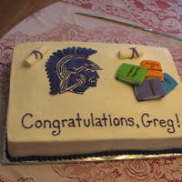 Spartan Graduation Cake This is a full sheet cake, covered in buttercream with fondant and royal icing accents. The spartan soldier is royal icing dried for a week...
