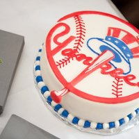 Yankees Cake This is a 10 inch cake covered in fondant with fondant accents.