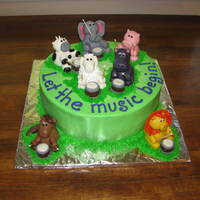 Let The Music Begin! This is a 10 inch cake covered in buttercream. The animals and drums are made of fondant. The drum sticks are toothpicks with royal icing...
