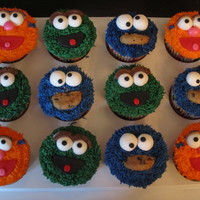 Sesame Street Cupcakes V.2.0 Made for the son of a friend who was turning 2. They coordinate with the Elmo cake I made for him, as well!
