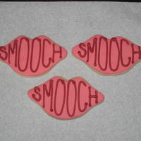 Smooches Wilton's design. I covered my cookies with Satin Ice; writing is royal icing (which could've been neater, now that I'm...