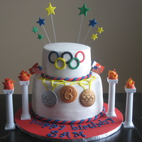 Olympics Birthday White chocolate sour cream cake w/SugarShack's buttercream. Client is placing figurines on top upon delivery. All accents are fondant...