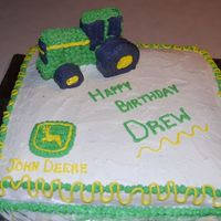 John Deere This cake was a lot of fun. I made the tractor out of Marshmallows. I cut them on certain sides in order for them to stick together. I ran...