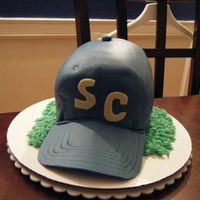 Baseball Cap this is a chocolate cake with vanilla frosting, covered with fondant.