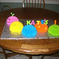 Catepillar Cake This is my take on the Wilton's catepillar cake. Made for a friend's baby's first birthday. It is white cake with...