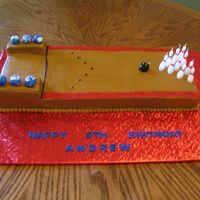 "Bowling Alley This is two 9x13 chocolate cakes placed end to end. I cut the second one about 3/4 of the way down. The ""ball return"" is made of..."
