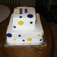 "Graduation Cake 10"" square and 6"" square, both white cake with white buttercream. The fondant dots and letters are actually purple and gold but..."