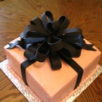 Pink And Black Cake 2 layer white cake with pink buttercream and black fondant bow. This was for one of my best friend's daughter's 18th birthday...