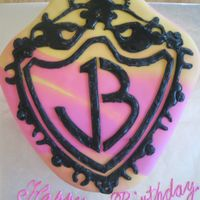 Jonas Brothers Cake Covered in pink and yellow marbled fondant. Logo done with royal icing.
