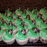 Football Cupcakes football cupcakes made to go along with a Ravens football cake for a tailgating event