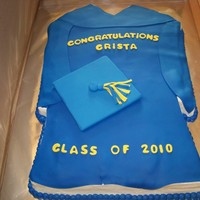 Graduation Gown And Cap A graduation gown cake, vanilla cake covered in white choc buttercream and then covered in fondant