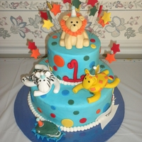 2 Tier Jungle Themed Cake A 2 tier jungle themed cake for a 1st birthday, cakes were both vanilla cake with vanilla buttercream, polka dots and a number 1 on the...