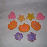 Fondant Covered Sugar Cookies A couple of firsts here. First time using the Marshmallow Fondant and first time making royal icing for decorating and also first time...