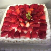 Strawberry Cake White chocolate cake with buttercream icing and fresh strawberries
