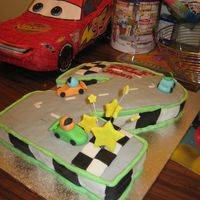 2Nd Birthday Race Car Cake I made this cake for my nephew's 2nd birthday. I thought I would make the shape of the #2 into a litle race track and have a couple...