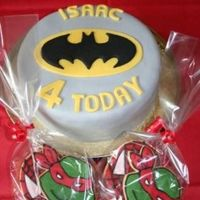 Batman Cake Cake and biscuits for my sons 'SuperHero' themed fourth birthday party. Batman logo is royal icing on sugarpaste and biscuits are...