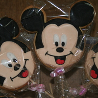 Mickey Mouse Cookies Butter cookes on sticks covered in Royal Icing for my sons 3rd birthday - a huge Mickey fan. They went down very well with all the children...